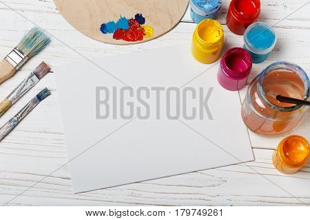poster of Art and craft tools.Artist's brush, canvas. Wooden art palette with tubes of acrylic paints.Artist's workshop.Art picture with copy space and for add text.Artist workplace background.Paints brushes