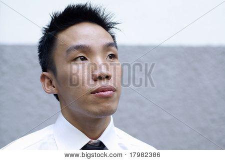 Aspiring asian male executive looking up