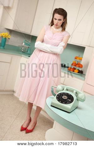 Woman Waiting By Telephone