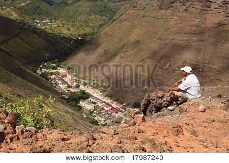 Hiker on hillside above Jamestown