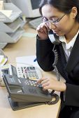 picture of asian woman  - businesswoman making a phone call - JPG