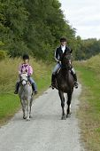 foto of horse riding  - Mother and duaghter on a trail ride with pony and horse - JPG
