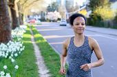 Active Athletic Young Woman Out Jogging poster