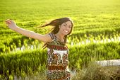 stock photo of asian woman  - Beautiful brunette indian young woman in the green rice fields meadow - JPG