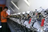 picture of karts  - Engines from kart cars in row line for been inspected - JPG