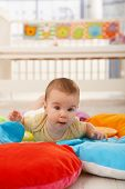 picture of playmate  - Sweet baby crawling on colorful playmat - JPG