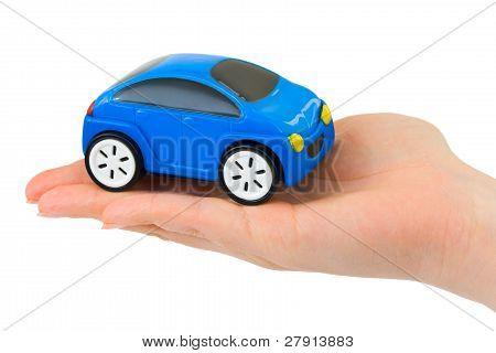 Hand und Spielzeug Auto