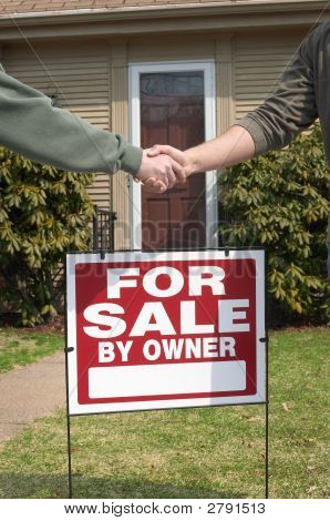 Handshake Over Home For Sale Sign