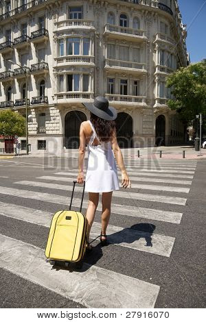 Female Walking With Suitcase On Crosswalk