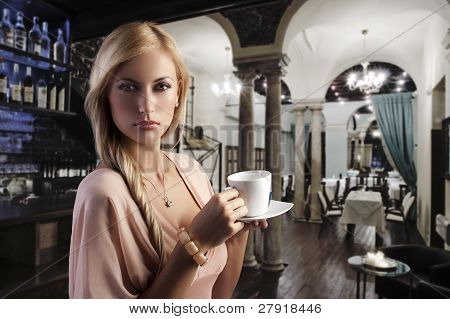 Blond Sensual Woman With A Cup