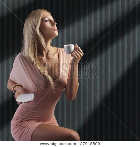 Blond Sensual Lady With A Cup Coffee
