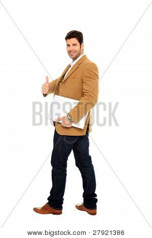 Businessman Holding A Laptop And Thumb Up