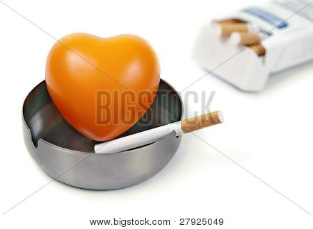 Orange Heart In The Ashtray And Cigarettes.