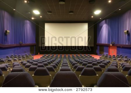 Empty Cinema Auditorium With Blue Walls And Chairs