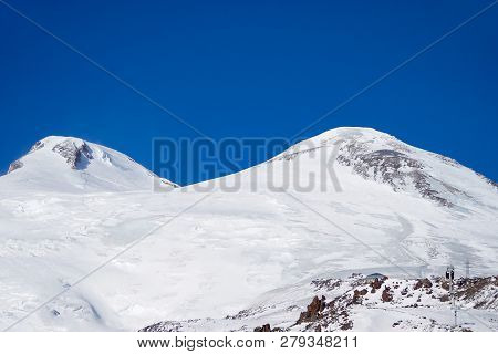 Snowboarding And Skiing The Peaks