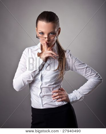 Sexy business woman silence sign