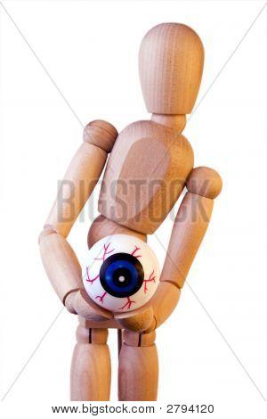 Wood Figure Holding Eyeball