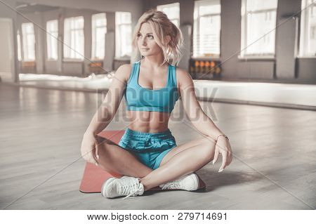 poster of Strong Sexy Athletic Young Woman Working Out In Gym