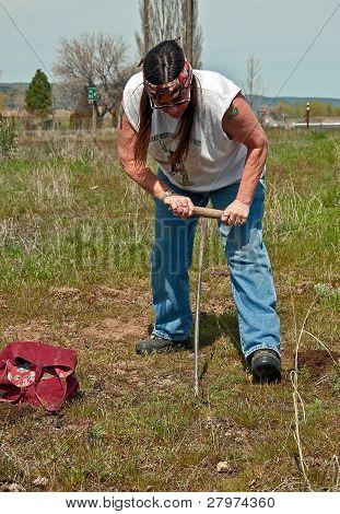 Native American Indian Woman Digging Camas In Traditional Way