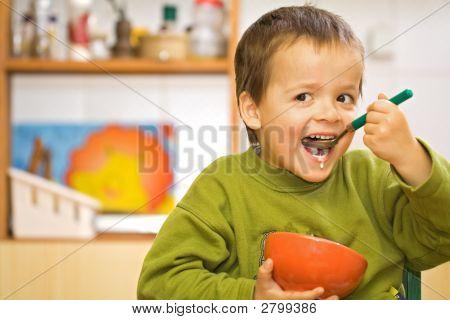Happy Boy Eating Breakfast - Cereals And Milk