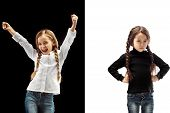 The Portrait Of Emotional Happy Winner Girl And Serious Girl On A White And Black Studio Background. poster