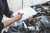 Services Car Engine Machine Concept, Automobile Mechanic Repairman Checking A Car Engine With Inspec poster