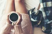 Close Up Legs Women On White Bed. Women Reading Book And Drinking Coffee In Morning Relax Mood In Wi poster