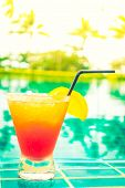 Mocktails Glass Around Swimming Pool In Hotel Resort - Vintage Filter And Sunflare Effect poster