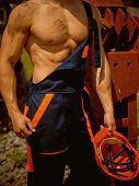 Muscular Concept. Muscular Body In Working Uniform. Muscular Activity. Muscular Strength And Power. poster