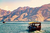 Sea, Pleasure Boats, Rocky Shores In The Fjords Of The Gulf Of Oman poster