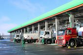 Large Green Industrial Gas Station For Refueling Vehicles, Trucks And Tanks With Fuel, Gasoline And  poster