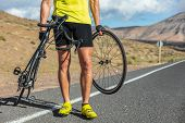 Bike repair cyclist man on side of road repair road bicycle problem with wheel. Cycling outdoor athl poster