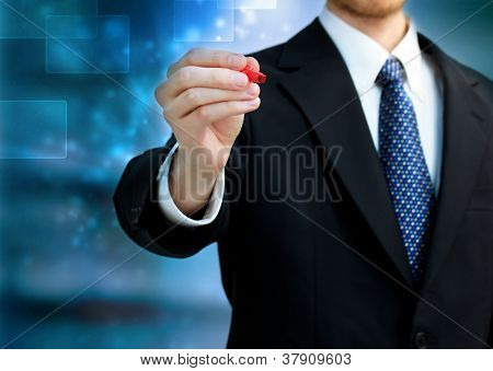 Business Man Holding A Red Pen