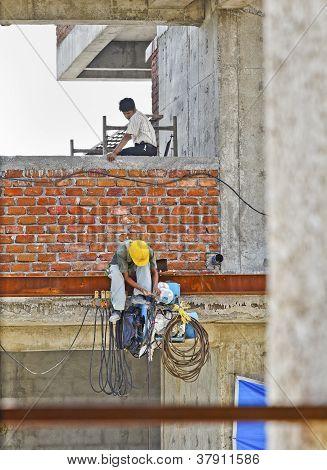 Man Servicing Repairing Equipment