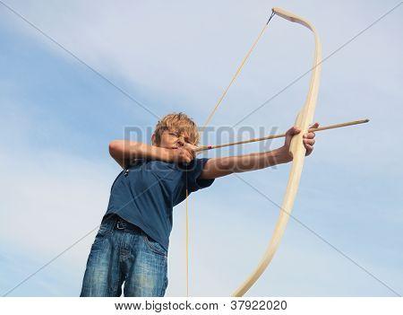 Boy Shoots A Bow At A Target