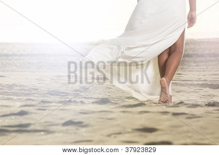 African Girl Walking On Sand