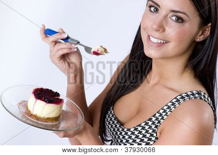 Attractive Woman Smiling Eats Cheescake