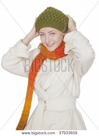 blond woman with scarf and coat on a winter day