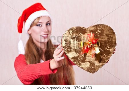 Young Woman In Santa Claus Hat With Gift Box