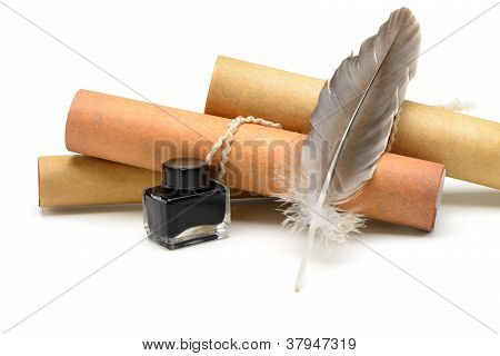 A Feather Pen, Ink,rolls Of Old Yellowed Paper