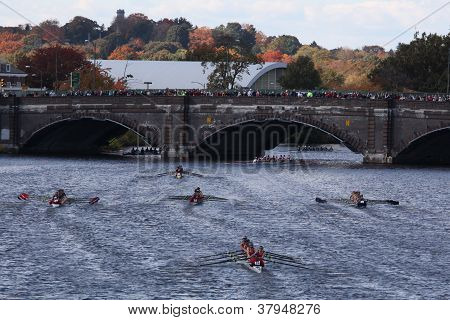Many teams race to go under the Anderson Bridge in the Head of Charles Regatta