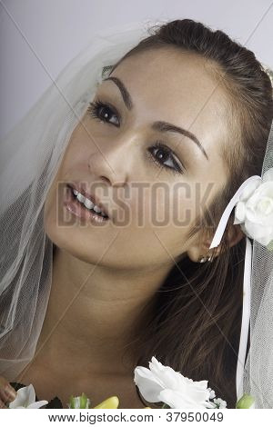 Young Bride In Veil With Bouquet