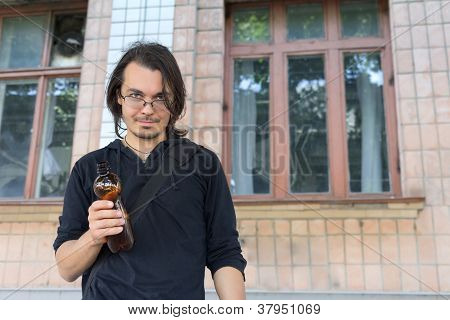Young Drunk  Man Holding  Plastic Bottle