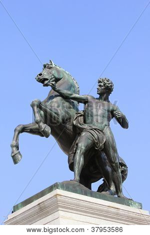 A statue of a horse tamer, architectural detail of Austrian Parliament in Vienna