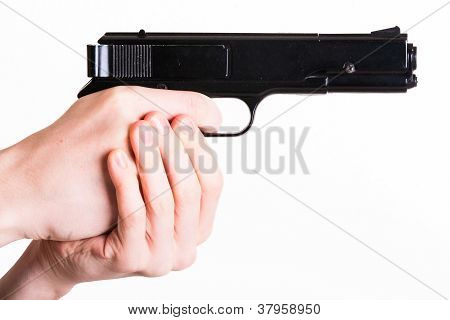 Teen Holds A Handgun