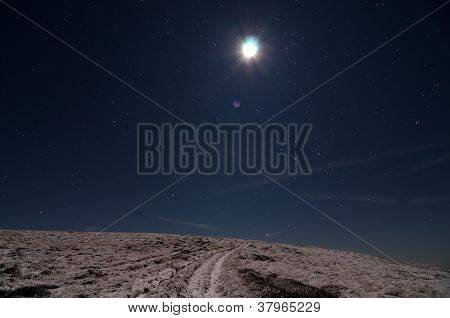 Moon Over Snowy Path
