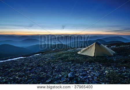 Tourist Tent In The Rocky Mountains And First Star
