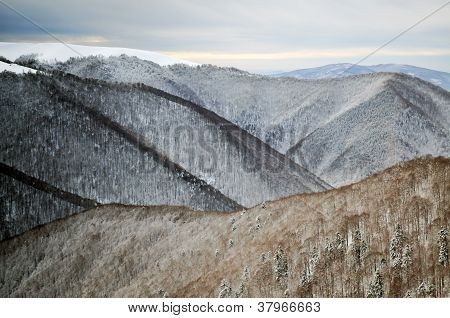 Snow Covered Ridges In The Mountains