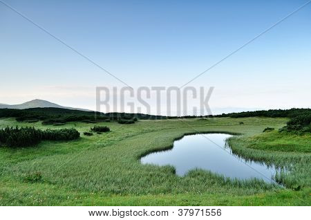 Morning Near Small Mountainous Pond