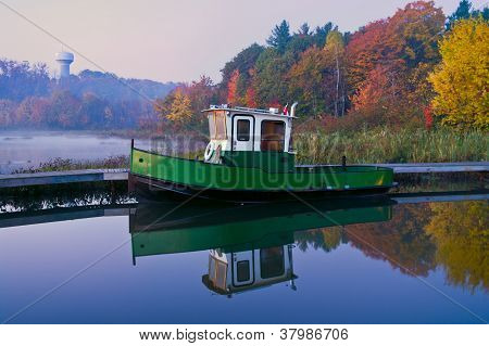 Boat at a Pier on a Misty Autumn Morning